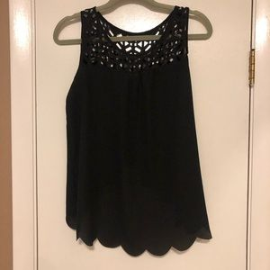 Cute black top with open back!